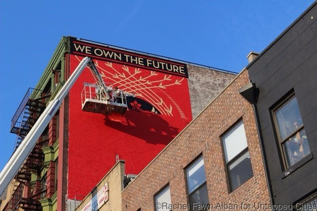 Shepard Fairey's 161 Bowery mural, in progress at the end of the first day.